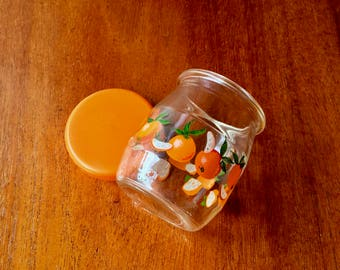 Retro small glass jar with oranges on it with orange plastic lid from 1970s Sweden, perfect for your kitchen