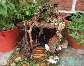 Fairy house made from moss, bark, shells and seaglass.