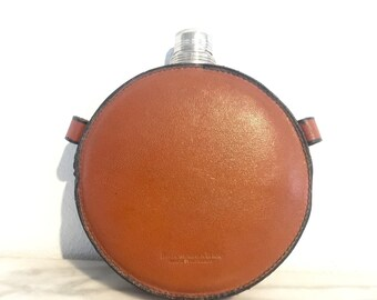 Vintage Abercrombie and Fitch Canteen Shaped Leather Covered Flask