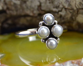 Four small Pearls set in a cluster Sterling Silver ring size 9