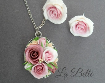 Set with roses from polymer clay. The pendant and studs