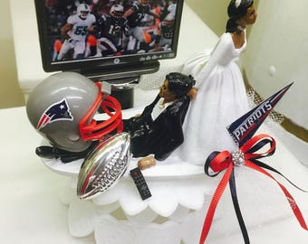 Patriots wedding cake topper, football cake topper, bride dragging groom,NFL cake topper, Bald Groom watching tv.  NFL cake topper