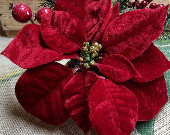 Poinsettia, greenery, and berry arrangement by The Chattanooga Wreath Company