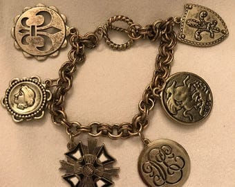 Fleur de lis motif, 1950's copper and metal charm bracelet