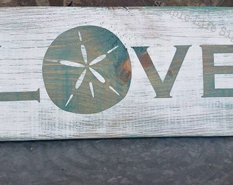 Sand dollar beach themed weathered wood sign LOVE.  Stained aqua, WHITEWASHED and distressed.