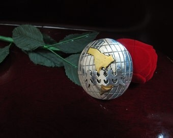 Hand made sterling silver globe and children in the middle two tone 925
