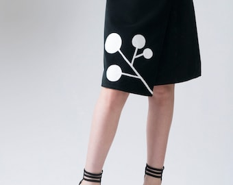 Women's skirt, asymmetrical hem wrap skirt, ladies skirt, A-line skirt, black skirt, applique detail, women's fashion, graphic skirt, skirt