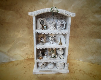 Open cabinet with many very nice details