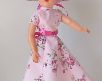 18 inch Miss Revlon doll dress. Pink floral print dress with matching hat.