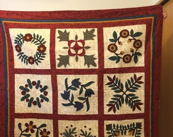 Sampler wallhanging handmade red and green machine appliqued