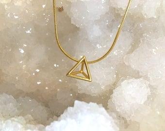Geometric gold charm necklace
