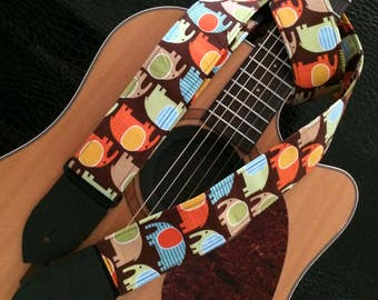 Fun elephant guitar strap -- multi-coloured on a brown background
