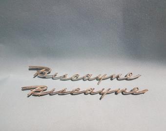 Vintage Pair of 1958 Chevy Biscayne Emblems