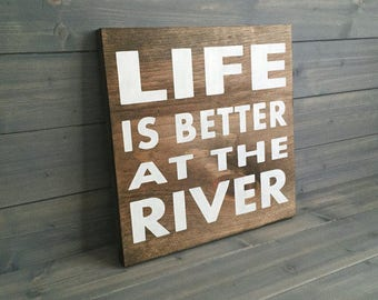 Life is Better at the river sign