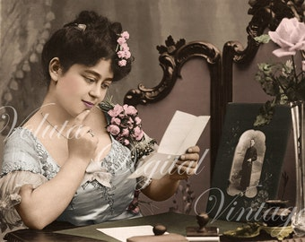 Woman reading a letter from her loved one  -  Edwardian Vintage Postcard.