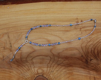 Lanyard with clear glass beads and blue and silver highlights