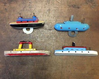 Collection of small wooden boats toys