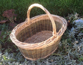 White and green oval shopping basket