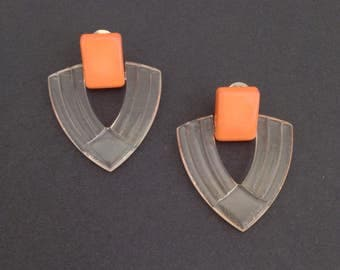 Large deco style vintage 1950s clear lucite clip on earrings