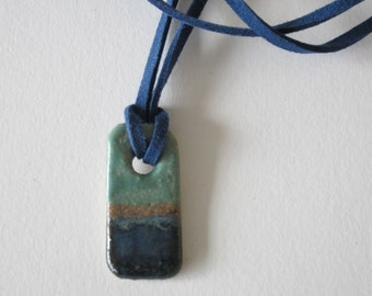 Seascape ceramic pendant with blue leather cord. Ideal gift