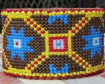 Beaded leather bracelet. Native american design. The hand woven beadwork