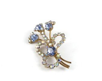 Flower pin, flower brooch from the 1950's, stunning blue rhinestones and aurora borealis, costume jewellery.