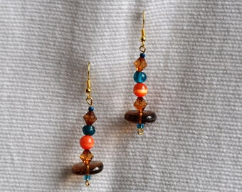 Unique and handmade. orange glass beads and tuquoise