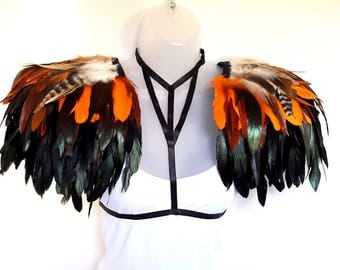 Feather epaulettes and body harness. Extra large shoulder pieces in black, orange and natural feathers. 3 in 1 look. Burning Man.