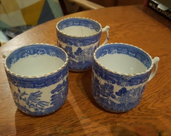 Victorian blue and white willow tea cups with gold trim