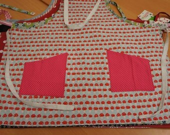 Kitchen apron made of light blue cotton with Toadstool-print and red-and white polka dots