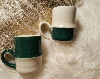 2 hand thrown mugs. Hand painted and dipped.