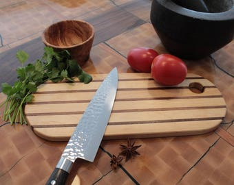 Birch and Walnut oval cutting board