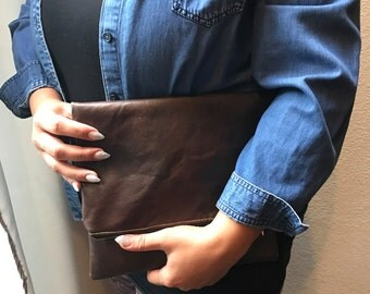 Dark brown faux leather fold over clutch