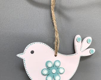 Light pink and shale green wooden hanging bird