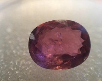 Pink-gold oval tourmaline gem