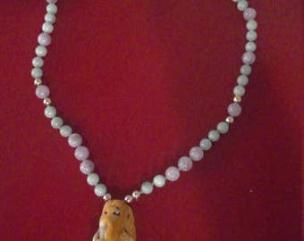 Rare caerved jade pendant on necklace of jade and amethyst beads, featuring gold-filled accent beads and clasp