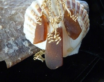 Brown sea glass necklace and earring set with gold spirals
