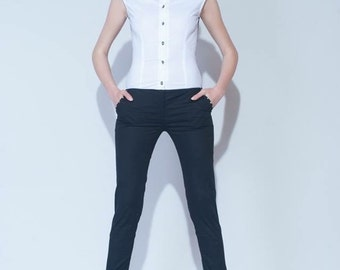 Jumpsuit: Spectacular designer jumpsuit from cotton with lace back. Buttons and Swarovski stones.