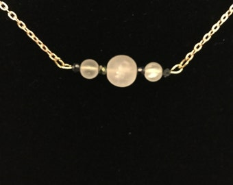 Simple white and black beaded necklace
