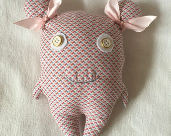"""handcrafted stuffed doll 