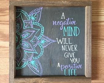 "Wooden sign ""a negative mind..."""