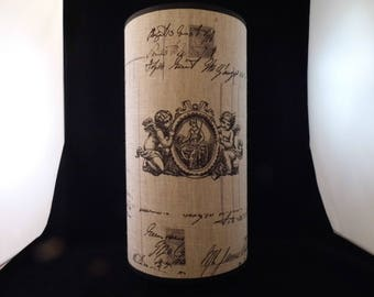 Cylindrical lamp decorated with angels and old writings