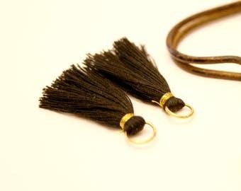 2 PomPoms black, metal gold ring