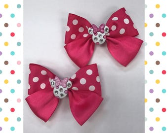 Two Minnie Mouse hairbows