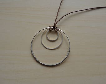 Necklace pendant and faux brown leather three circles