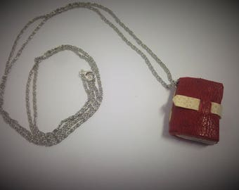 Pendant with leather and paper, in book form