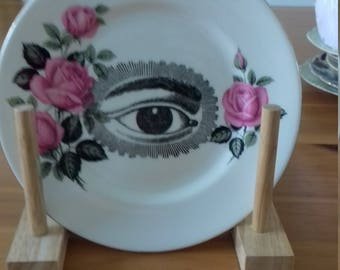Small decorative vintage plate decorated with a steam rock print