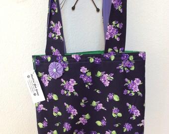 violets on navy market bag