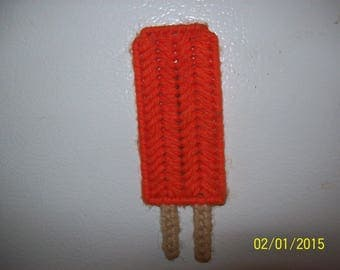 Popsicle stick magnets made of plastic canvas and yarn