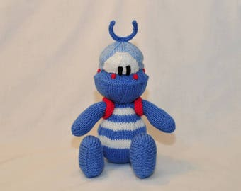 TwoTwo.  A stunning blue striped alien, with his cute antenna and a yellow rucksack with red shoulder straps. Hand knitted toy alien.